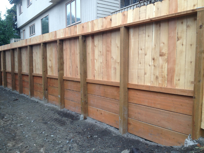 Backyard makeovers with pool retaining wall vs fence for Garden wall fence ideas